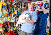 "Volunteer photographer Penny Adams holding ""Buddha"" the cat at the Cat Shoppe and Dog Store. Buddha was just rescued from Metro Animal Care and Control. He weighs in at a whopping 31.4 pounds. The Cat"
